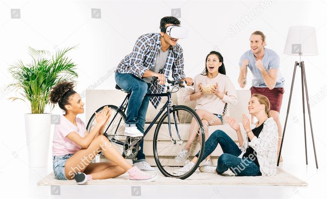 Man riding bicycle while wearing VR headset... in a living room